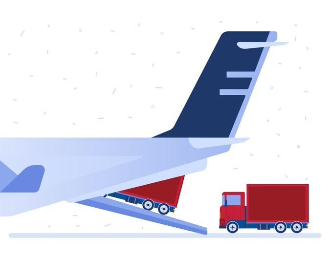 Trucks driving onto an airplane loading ramp