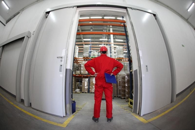 Man inspecting warehouse storage